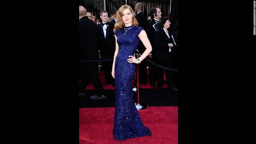 "In 2011, the year Amy Adams was nominated for her role in ""The Fighter,"" she paired her navy blue L'Wren Scott gown with emerald and diamond jewels."