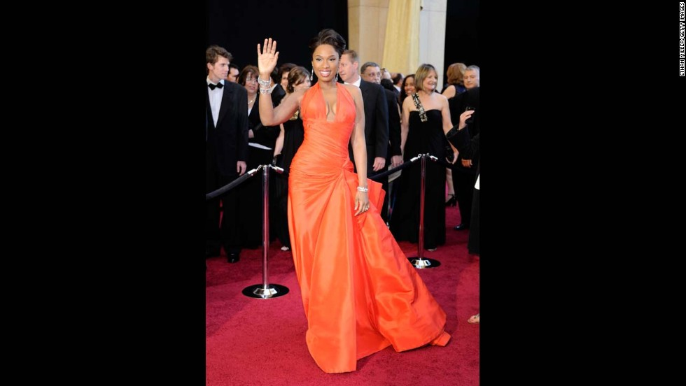 Jennifer Hudson showed off her impressive weight loss at the 2011 Academy Awards wearing a tangerine-colored Atelier Versace gown.