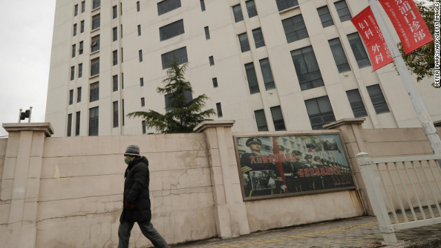 A person walks past a 12-storey building alleged in a report on February 19, 2013 by the Internet security firm Mandiant as the home of a Chinese military-led hacking group after the firm reportedly traced a host of cyberattacks to the building in Shanghai's northern suburb of Gaoqiao. Mandiant said its hundreds of investigations showed that groups hacking into US newspapers, government agencies, and companies 'are based primarily in China and that the Chinese government is aware of them.'