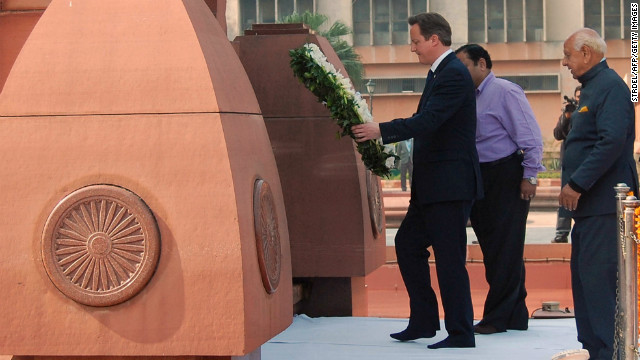 British Prime Minister David Cameron lays a wreath in tribute to the Jallianwala Bagh martyrs at the Jallian wala Bagh memorial in Amritsar on February 20, 2013.