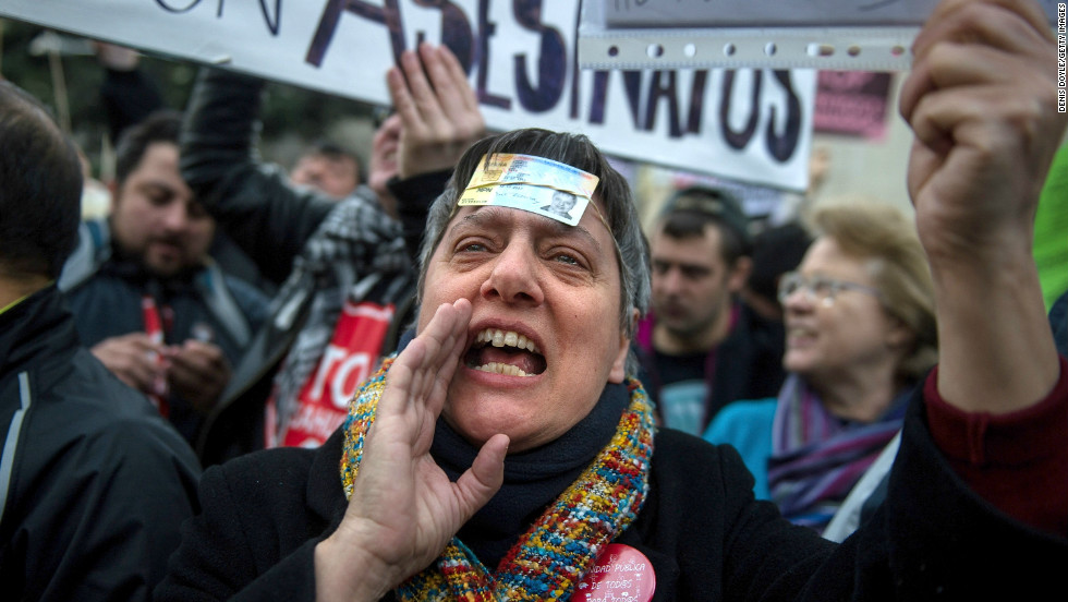 People protest against the Spanish laws on house evictions outside the Spanish parliament on February 12 in Madrid, Spain.
