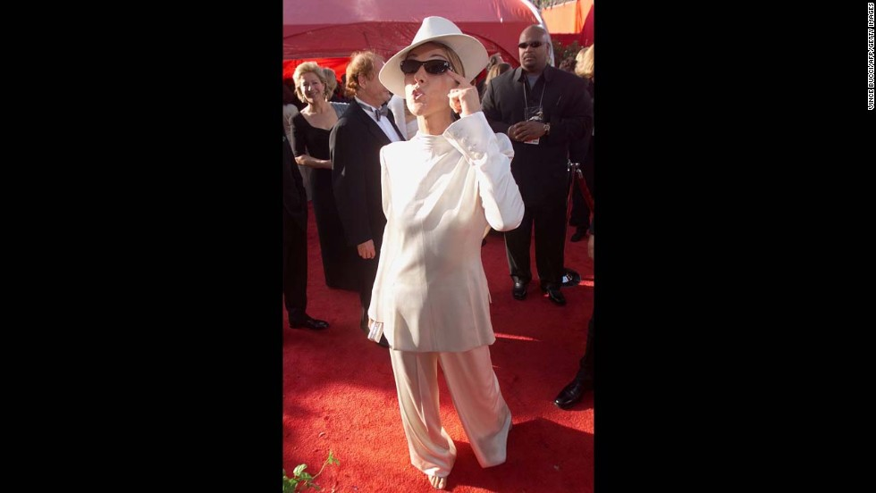 Celine Dion took a fashion risk in 1999 when she wore a white suit and hat, with the Jacket backwards.