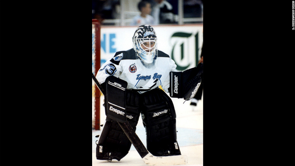 Goalie Manon Rheaume of the Tampa Bay Lightning defends the net during an NHL preseason game against the St. Louis Blues in Tampa on September 23, 1992. She was the first female to play in an NHL game.