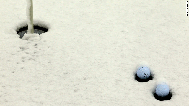 Snow covers a practice putting green in Arizona on the opening day of the Match Play Championships