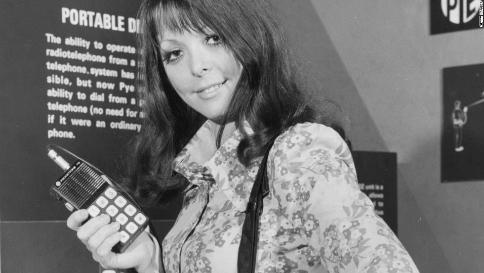 "In this image from 1972, a model demonstrates a ""portable radio-telephone"" by Pye Telecommunications at a London exhibition called ""Communications Today, Tomorrow and the Future."""