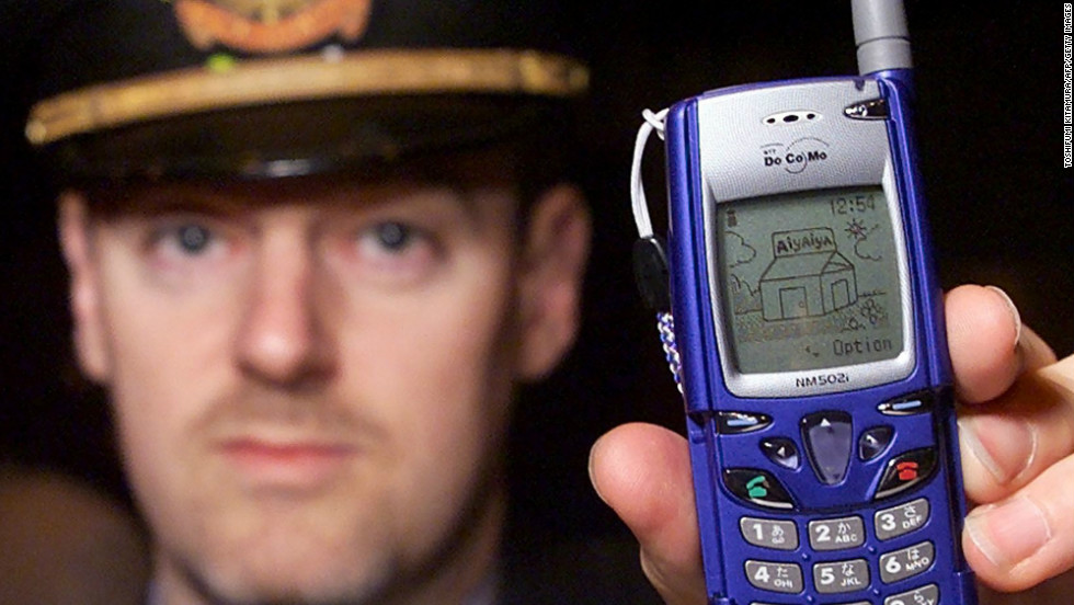 Nigel Rundstrom of Nokia shows off the company's new mobile phone, the catchily named DoCoMo Nokia NM502i, in Tokyo in March of 2000. No explanation was given for his hat.