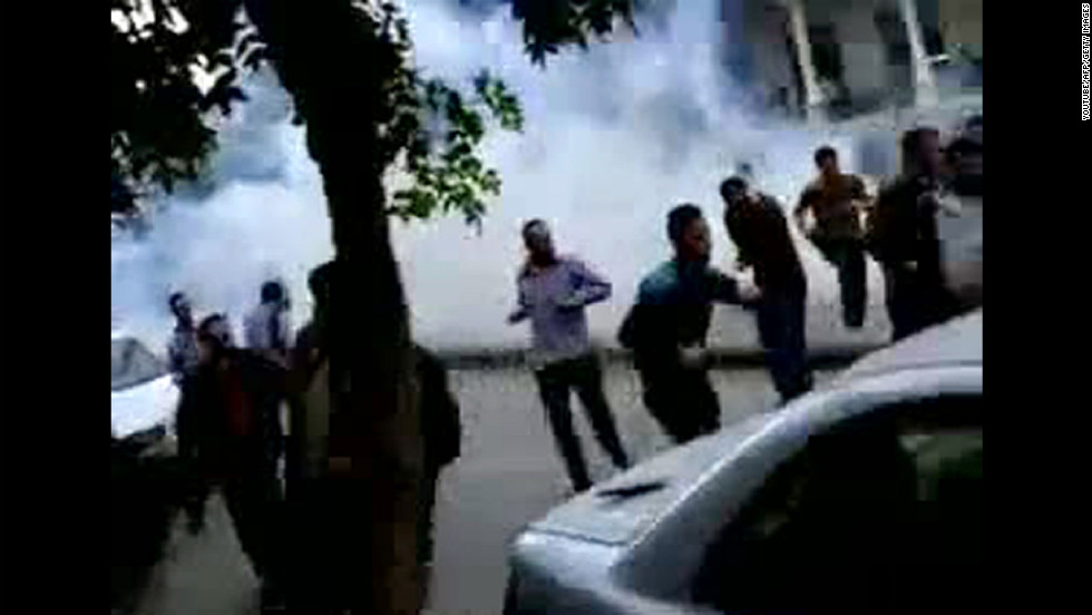 "A screen grab from YouTube shows Syrian anti-government protesters run for cover from tear gas fired by security forces in Damascus on April 29, 2011, during the ""Day of Rage"" demonstrations called by activists to put pressure on al-Assad."