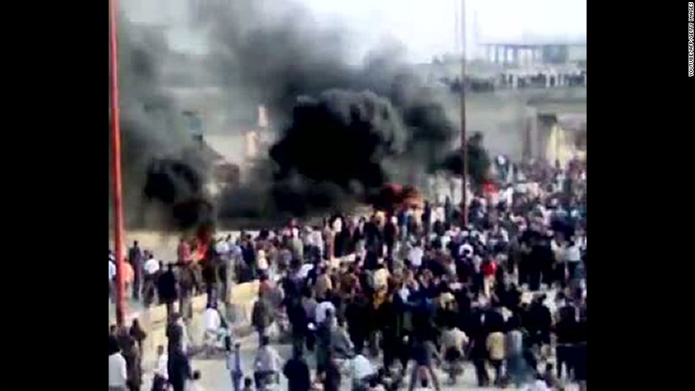 A screen grab from YouTube shows thick smoke rising above as Syrian anti-government protesters demonstrate in Moaret Al-Noman on April 29, 2011.