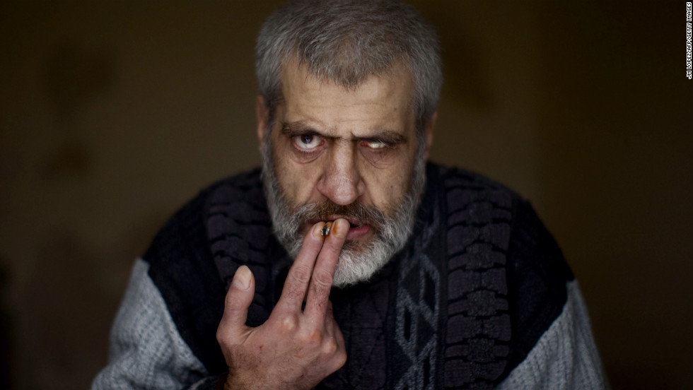 A patient smokes a cigarette at Dar Al-Ajaza psychiatric hospital in Aleppo on December 18, 2012. The psychiatric ward, housing around 60 patients, has lacked the means to function properly since fighting broke out there in July.
