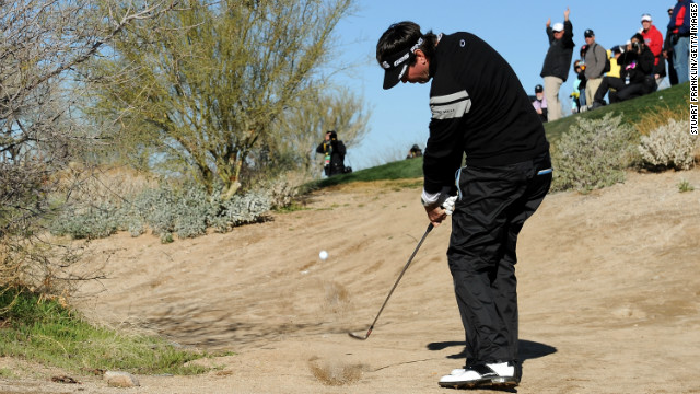 Bubba Watson tries to play his way out of trouble on the fourth hole at Dove Mountain on February 23.