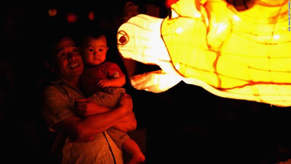 A man and a child view the Chinese lanterns on display in Albert Park on Friday, February 22, in Auckland, New Zealand.
