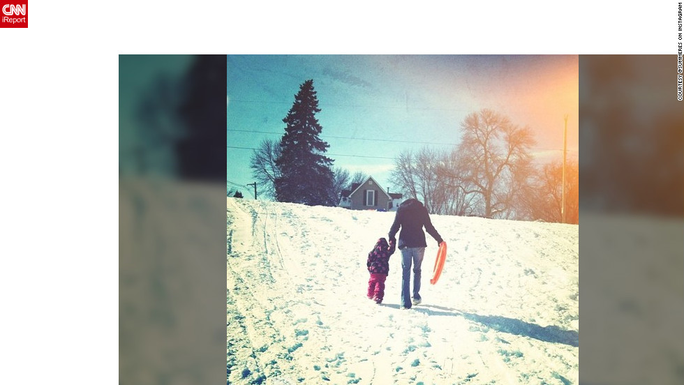 "<a href=""http://ireport.cnn.com/docs/DOC-932230"" target=""_blank"">Summer Sorum</a> snapped this sweet photo of her 2-year-old niece holding mom's hand up a snowy hill. ""It snowed 10 inches in Minnesota so naturally who wouldn't want to go sledding? It was her first time,"" she said. ""This is the hill my siblings and I went sledding on as children too."""