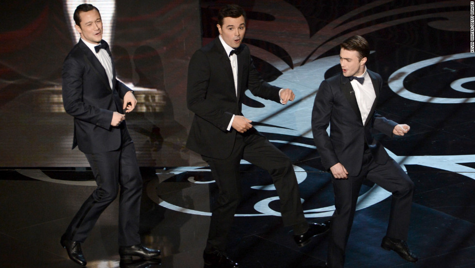 "Joseph Gordon-Levitt, left, and Daniel Radcliffe, right, join MacFarlane onstage for a rendition of ""High Hopes."""