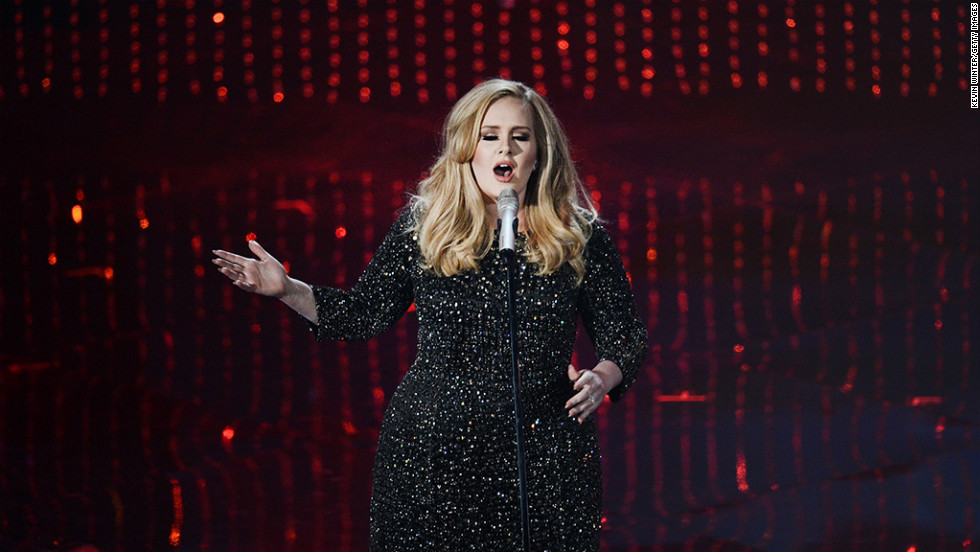 "Adele performs ""Skyfall"" onstage in a sparkly dress and shoes."