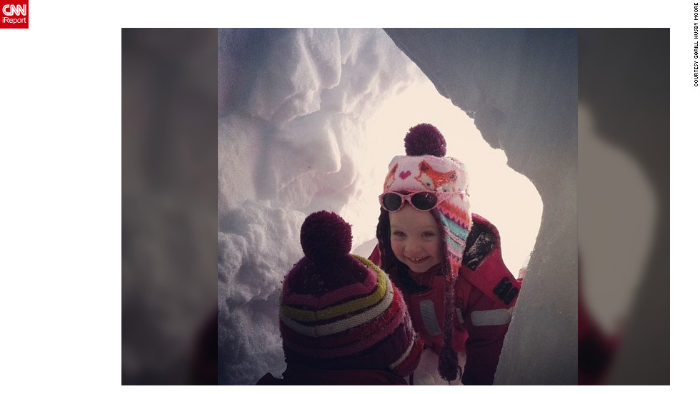 "<a href=""http://ireport.cnn.com/docs/DOC-932875"" target=""_blank"">Gørill Husby Moore</a>'s daughter plays peekaboo with her younger cousin in a snow cave they built."