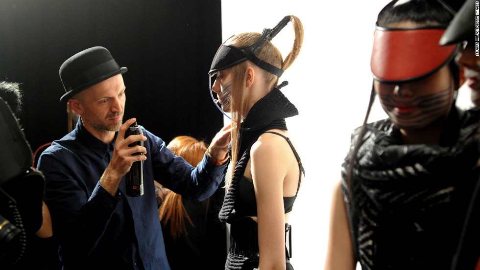 Models prepare backstage at the Haizhen Wang show.