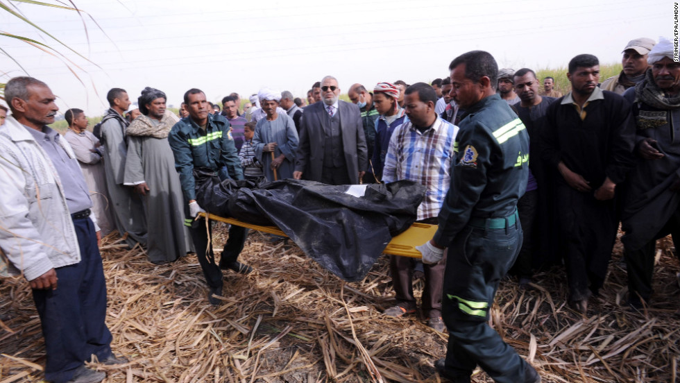 Egyptian medics carry a body on a stretcher.