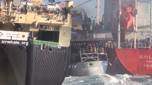 Watch ships sandwich activist vessel
