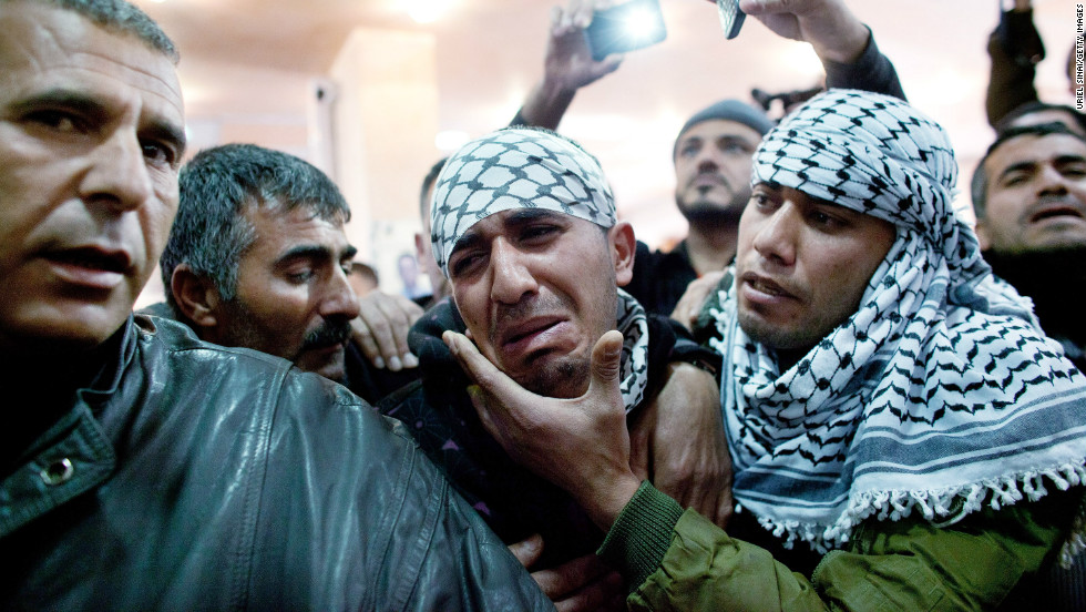 Palestinians mourn during the funeral Arafat Jaradat on February 25, 2013 in the village of Saair in the West Bank.