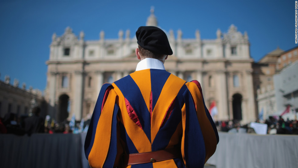 A Swiss guard stands in front of the Vatican.