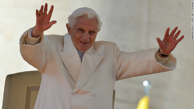 Pope Benedict XVI blesses the faithful before leaving the altar at the end of his last weekly audience on February 27, 2013 at St Peter's Square.
