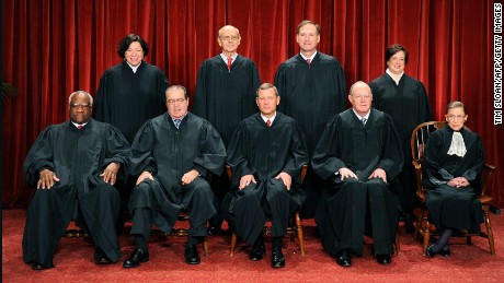 The Justices of the US Supreme Court sit for their official photograph on October 8, 2010 at the Supreme Court in Washington, DC. Front row (L-R): Associate Justice Clarence Thomas, Associate Justice Antonin Scalia, Chief Justice John G. Roberts, Associate Justice Anthony M. Kennedy and Associate Justice Ruth Bader Ginsburg. Back Row (L-R): Associate Justice Sonia Sotomayor, Associate Justice Stephen Breyer, Associate Justice Samuel Alito Jr. and Associate Justice Elena Kagan. AFP PHOTO / TIM SLOAN/Getty Images