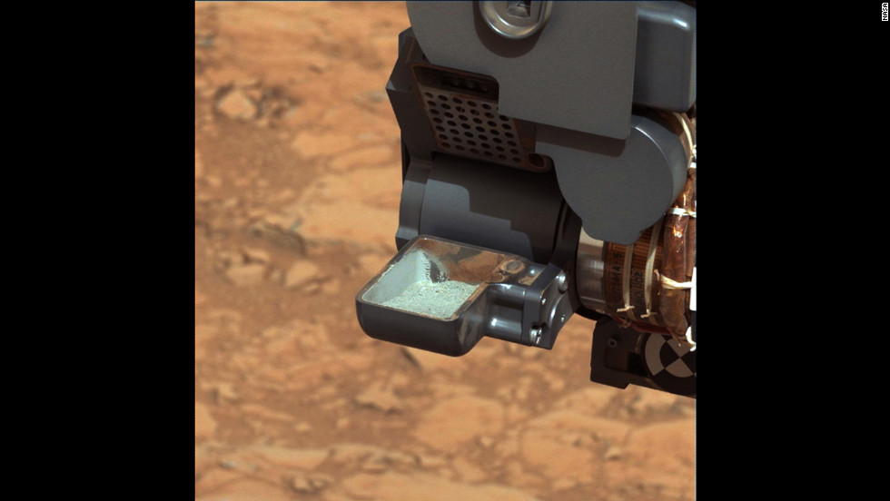Curiosity shows the first sample of powdered rock extracted by the rover's drill. The image was taken by Curiosity's mast camera on February 20, 2013.