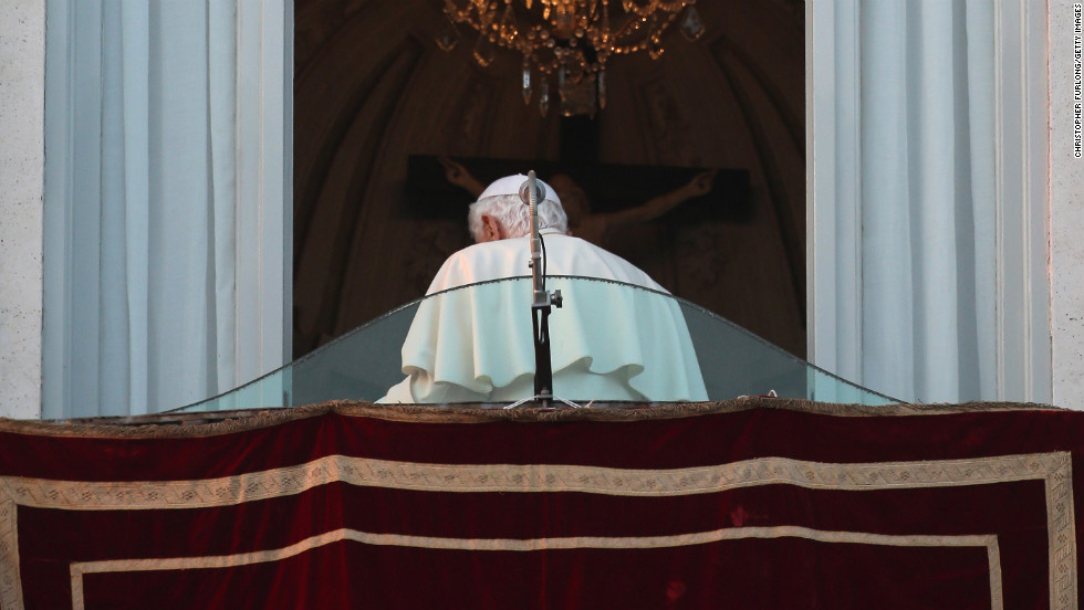 Pope Benedict XVI walks away from the window at Castel Gandolfo for the last time as head of the Catholic Church. He started his retirement February 28.