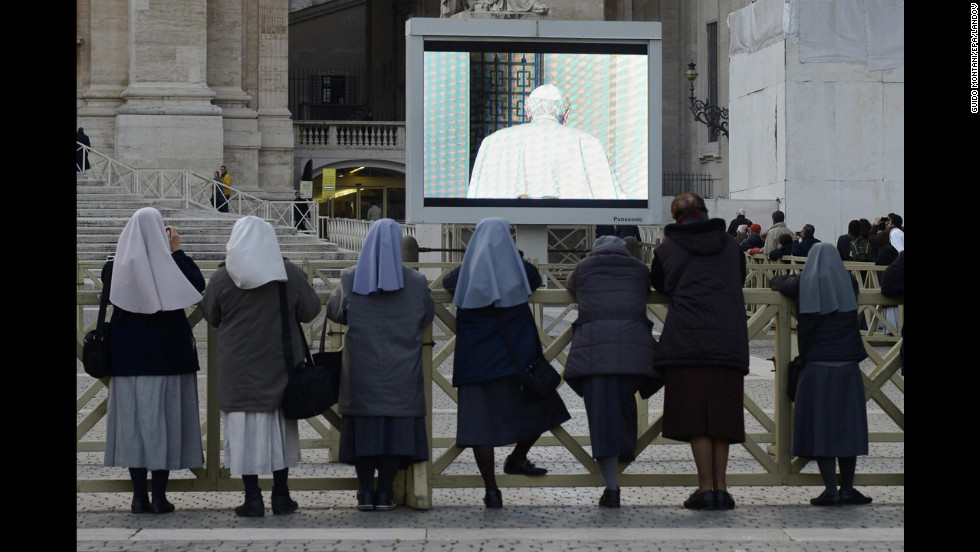 Nuns watch from Vatican City as Pope Benedict XVI leaves the balcony of the papal summer residence in Castel Gandolfo.