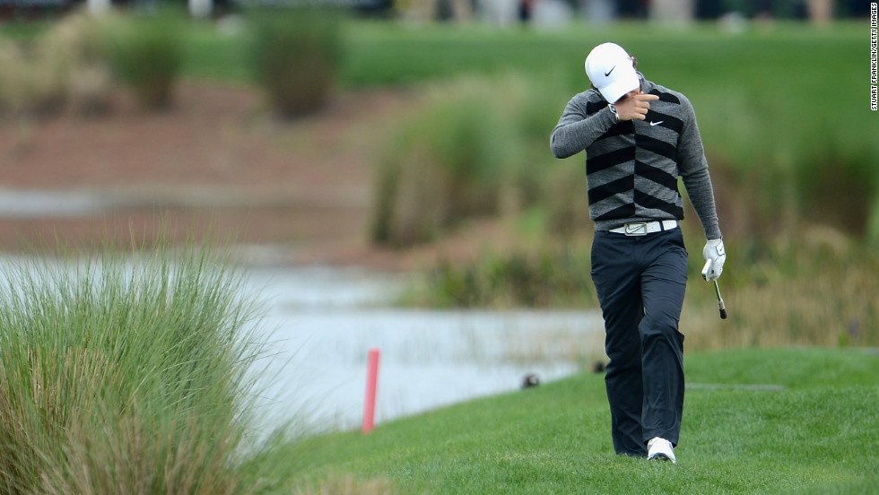 McIlroy looks crestfallen after finding the water again during his disastrous second round of the Honda Classic.