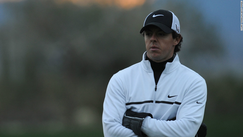 Gathering gloom: McIlroy suffered a first round defeat to Ireland's Shane Lowery at the WGC Match Play event in Arizona last week.
