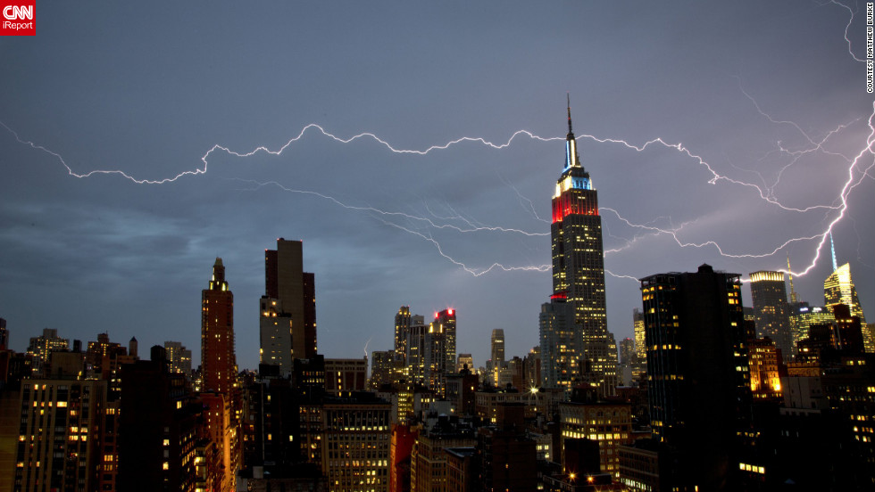 "<a href=""http://ireport.cnn.com/docs/DOC-821097"">Matthew Burke</a> shot this dramatic lightning strike from his Manhattan apartment window in July 2012. ""There was very strong rain and wind for about 15 minutes, at which point the rain cleared and the lightning show began,"" he said."