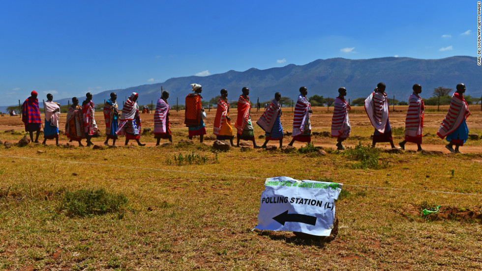 Maasai tribes-people leave after voting in Ilngarooj, Kajiado South County, Maasailand, on March 4, 2013 during Kenya's elections.