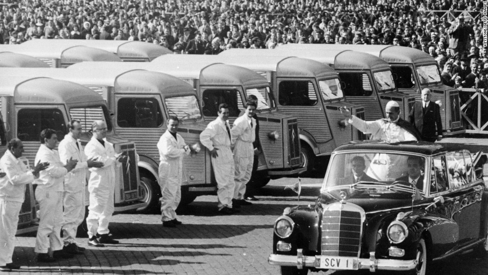 1966: Pope Paul VI blesses lorries from the back of a Mercedes-Benz in St. Peter's Square, Rome, before they are shipped to famine-stricken areas of India.