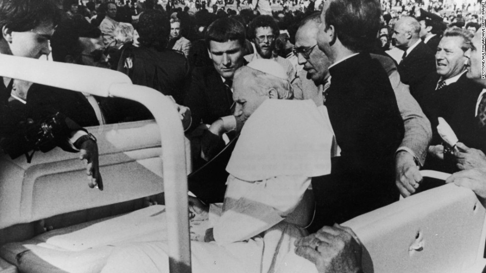 Pope John Paul II is shot by would-be assassin Mehmet Ali Agca in St. Peter's Square on May 13, 1981. Following the assassination attempt, the Popemobile was equipped with bullet-proof glass.