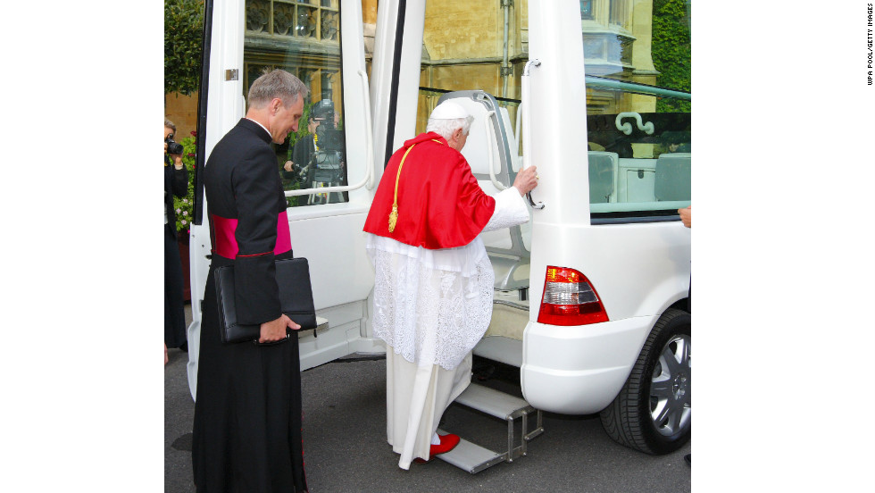This picture shows the way the pope enters a Popemobile. The back door is opened, revealing a small staircase to help him board smoothly.(September 17, 2010 in London, England)