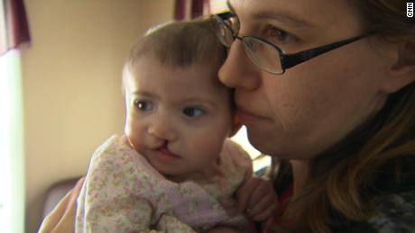 Crystal Kelley holds her baby, Seraphina Harrell, in 2012 before Kelley, the baby's surrogate mother, gave the infant up for adoption to the Harrell family of Massachusetts.