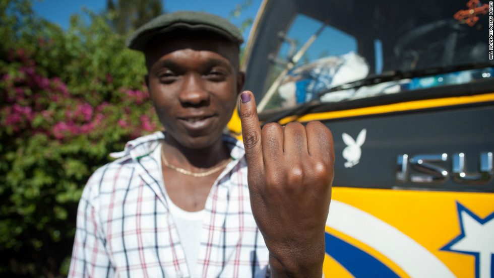 A man shows his inked finger, which marks that he has voted in Kangemi, Nairobi.