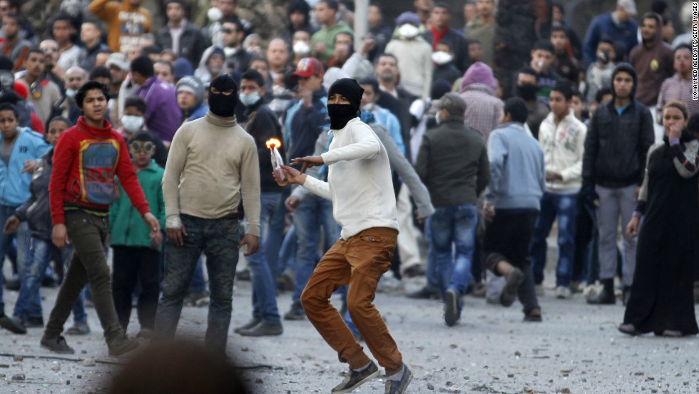 The mass demonstrations in Cairo's Tahrir Square have often been violent. In this picture, taken on January 30, 2013, a masked protester readies to throw a molotov cocktail.