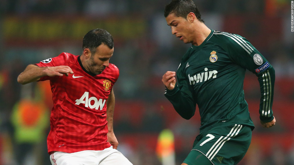 Manchester United's veteran star Ryan Giggs battles for the ball with Ronaldo in a midfield tussle.