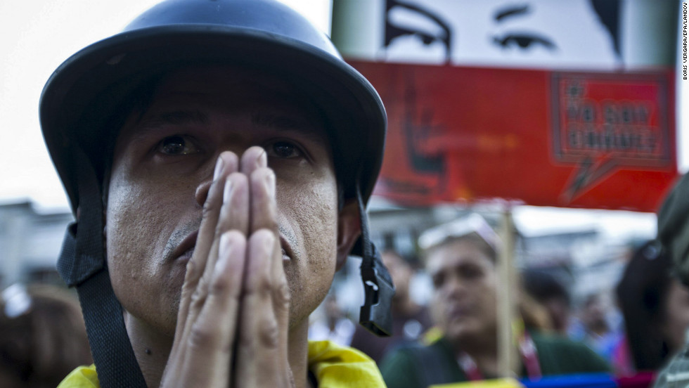 A man mourns the death of Chavez outside the Military Hospital in Caracas on March 5.