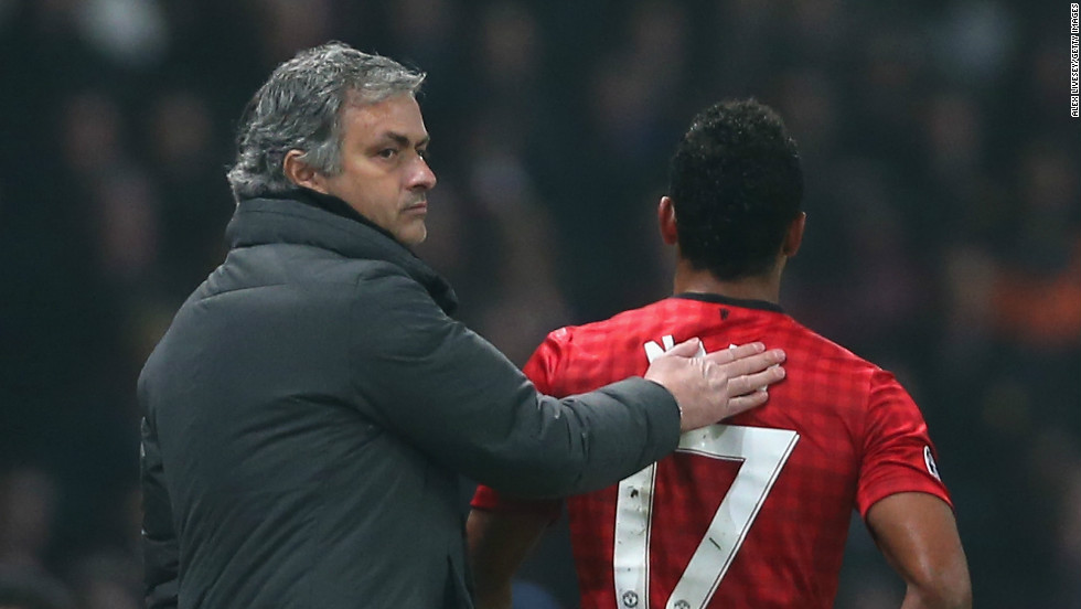 Real manager Mourinho consoles Nani after the Portuguese international is red carded at Old Trafford.