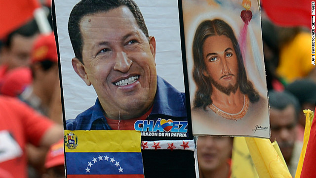 A supporter of Venezuelan President Hugo Chavez holds a poster of Chavez next to an image of Jesus Christ, outside Miraflores presidential palace during an event in homage of nation's leader, in Caracas on January 10, 2013. With Chavez ailing and absent, Venezuela's leftist government launches a new presidential term with a display of popular support on the day he was to be inaugurated. The Supreme Court cleared the cancer-stricken president,kwho is recovering from a fourth round of cancer surgery in Havana, to indefinitely postpone his re-inauguration and said his existing administration could remain in office until he is well enough to take the oath. The government has said that he is recovering from complications from surgery, most recently a severe pulmonary infection that had resulted in a 'respiratory insufficiency.' AFP PHOTO/JUAN BARRETO (Photo credit should read JUAN BARRETO/AFP/Getty Images)