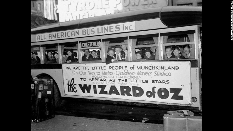 The actors who portrayed the Munchkins aboard a bus headed to the studio for filming.
