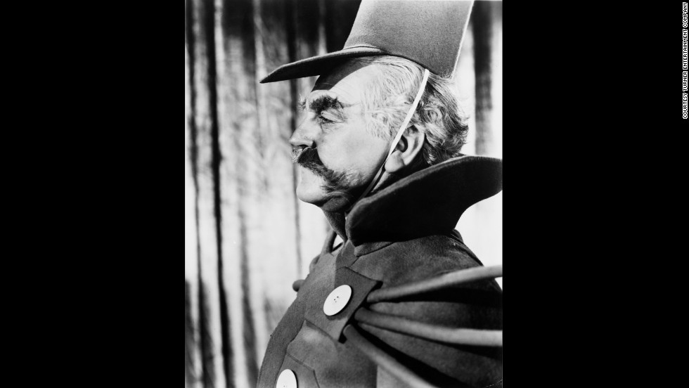 Frank Morgan as the Guardian of the Gates.