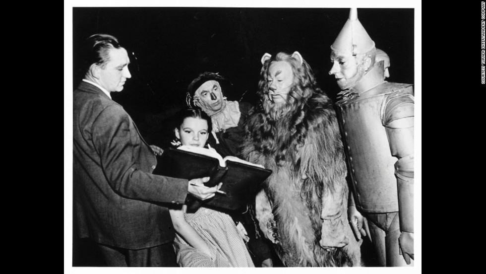Judy Garland as Dorothy Gale, Ray Bolger as the Scarecrow, Bert Lahr as the Cowardly Lion and Jack Haley as the Tin Man.