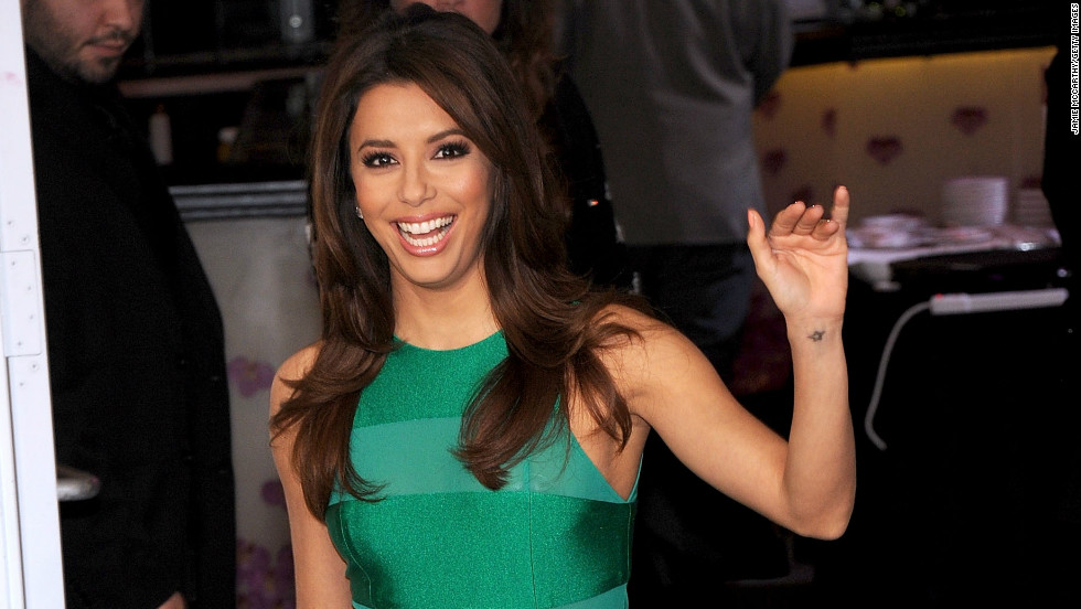 Eva Longoria waves as she arrives at the Feed Your Passion Campaign launch in New York on March 7.
