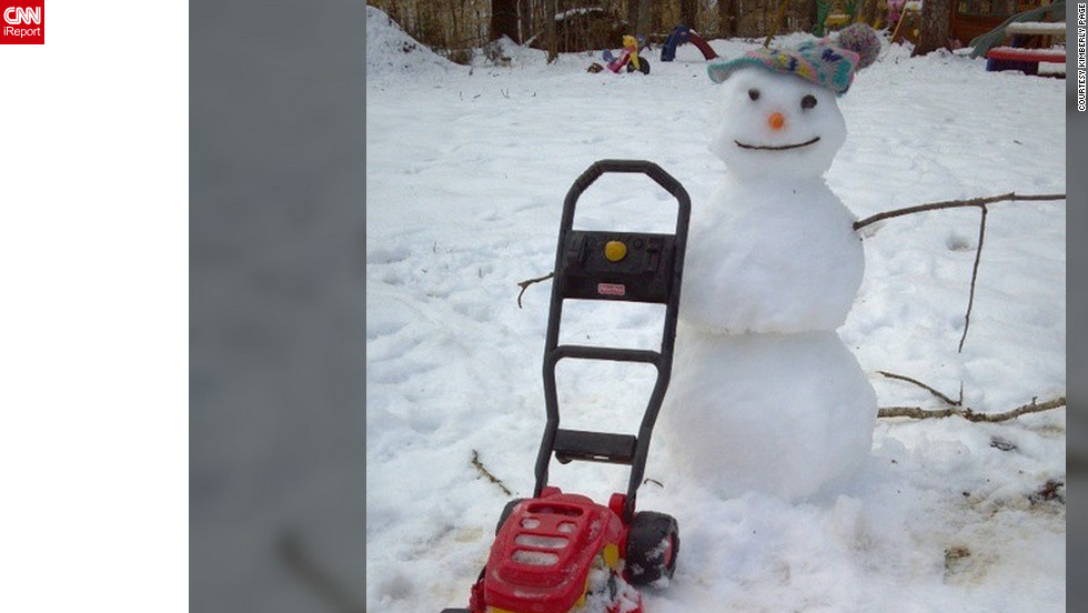 "<a href=""http://ireport.cnn.com/docs/DOC-938219"">Kimberly Page</a> from Dillwyn, Virginia, spent her snow day this week with her daughters. On the morning of March 7, she and her two toddlers came together and built a snowman. ""I just like being able to enjoy my snow days with my two little girls. They love playing in the snow, but we had to get outside early this morning before it all melted away,"" she said."
