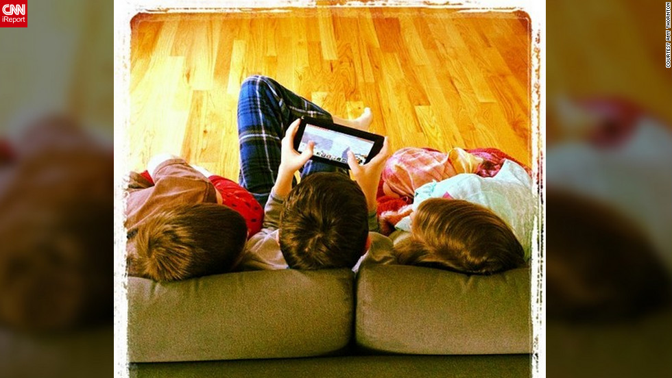 "<a href=""http://ireport.cnn.com/docs/DOC-938119"">Amy Thornton</a> from Crozet, Virginia, woke at eight in the morning and found her three young children huddled together on the living room couch, playing with their Kindle. ""A snow day is like this little stolen moment. Stolen from routine and rat-race,"" she said. ""The highlight was getting to all play together, making memories."""