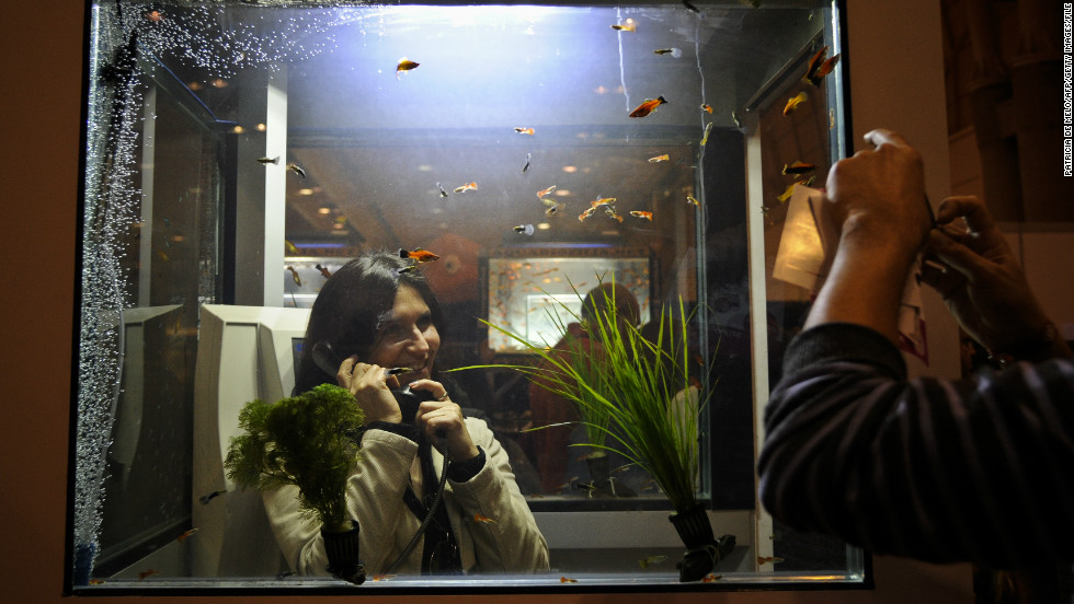It's not all about the ultramodern. Some phone booths have been redesigned to take on all manner of cool and interesting artistic concepts, like this kiosk that doubles up as a customized aquarium in Lisbon, Portugal.